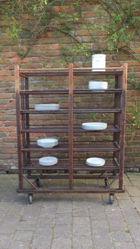 Early 20th Century Pine Slatted Shoe Rack on Castors
