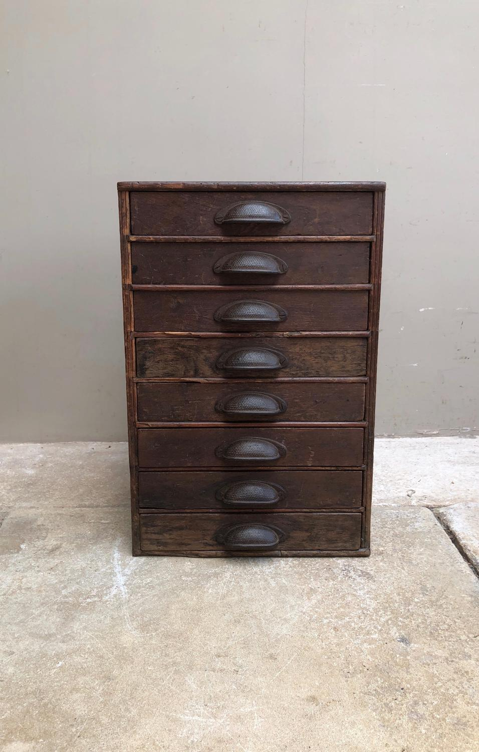 Early 20thC Pine Flight of Eight Drawers - Full Set Cast Handles