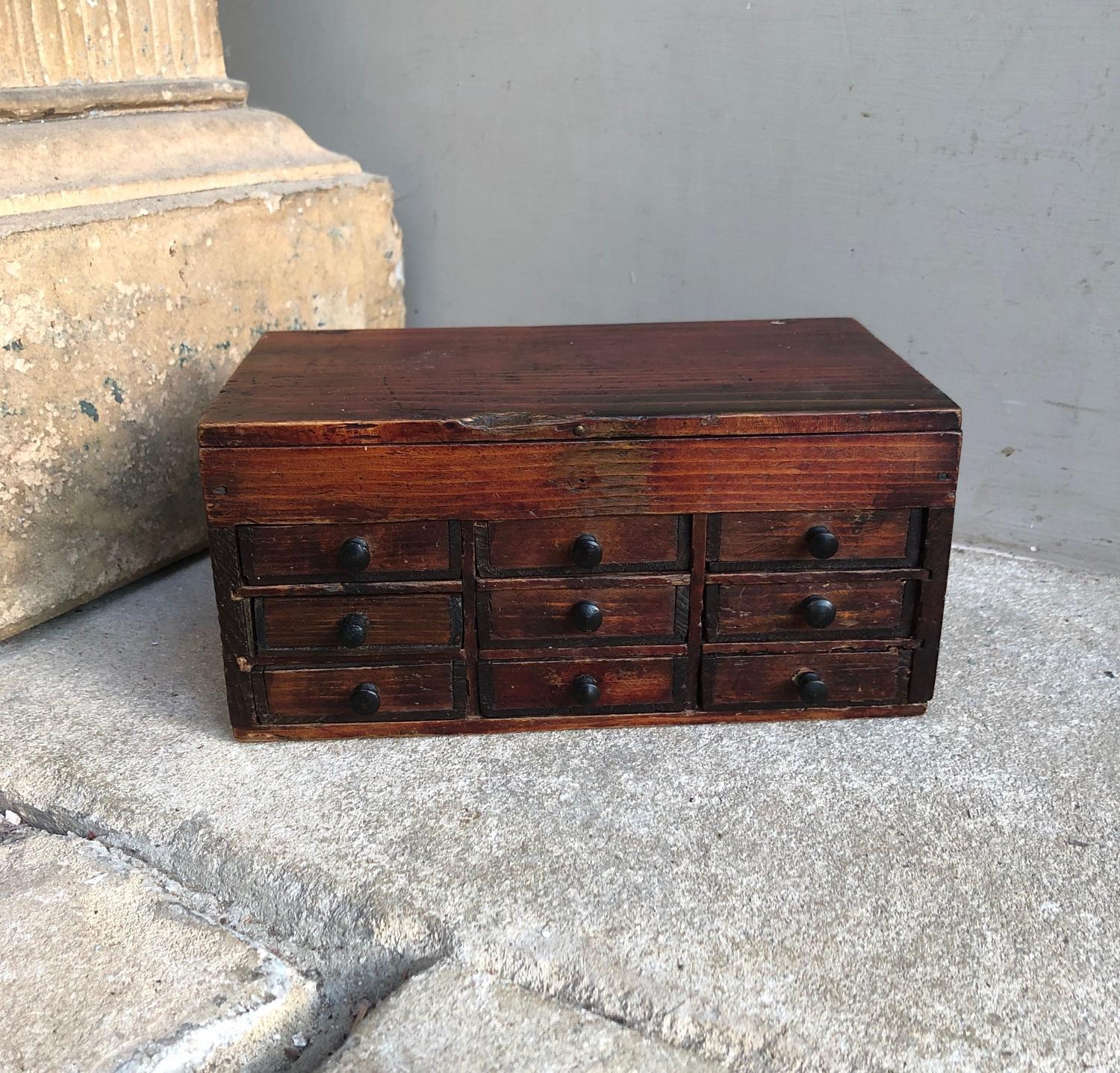Early 20thC Watchmakers Pine Bank of Nine Drawers with Lift Up Lid