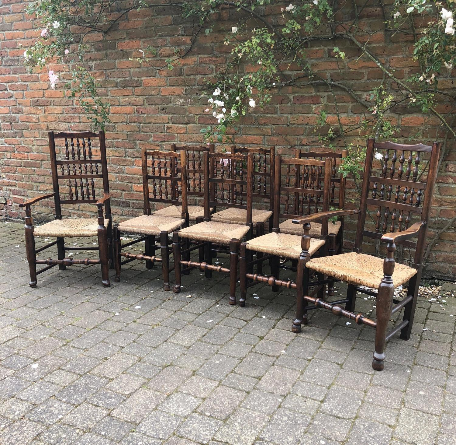 Eight Early Victorian Elm Spindle Back Rush Seat Chairs