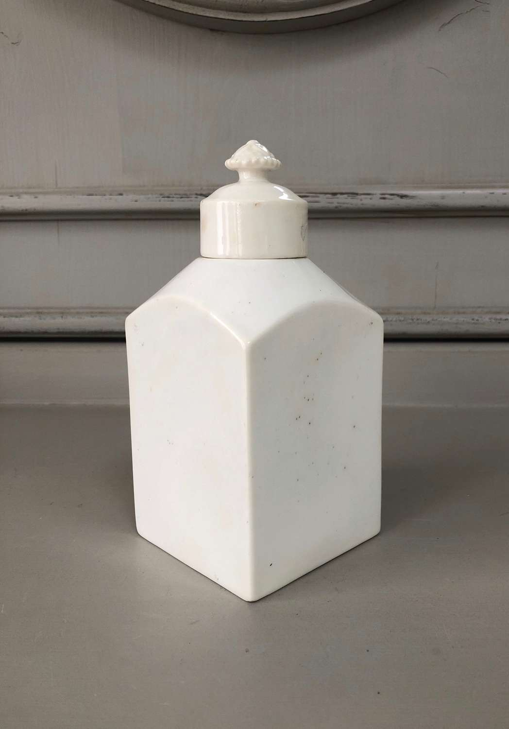 Small Late Victorian White Ironstone Bottle with Floral Top Lid.