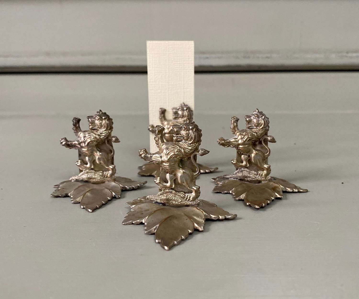 Early 20th Century Set of Four English Lion Table Place Name Holders