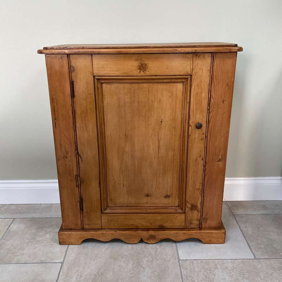 Early 20th Century Pine Cupboard with Shaped Plinth Front