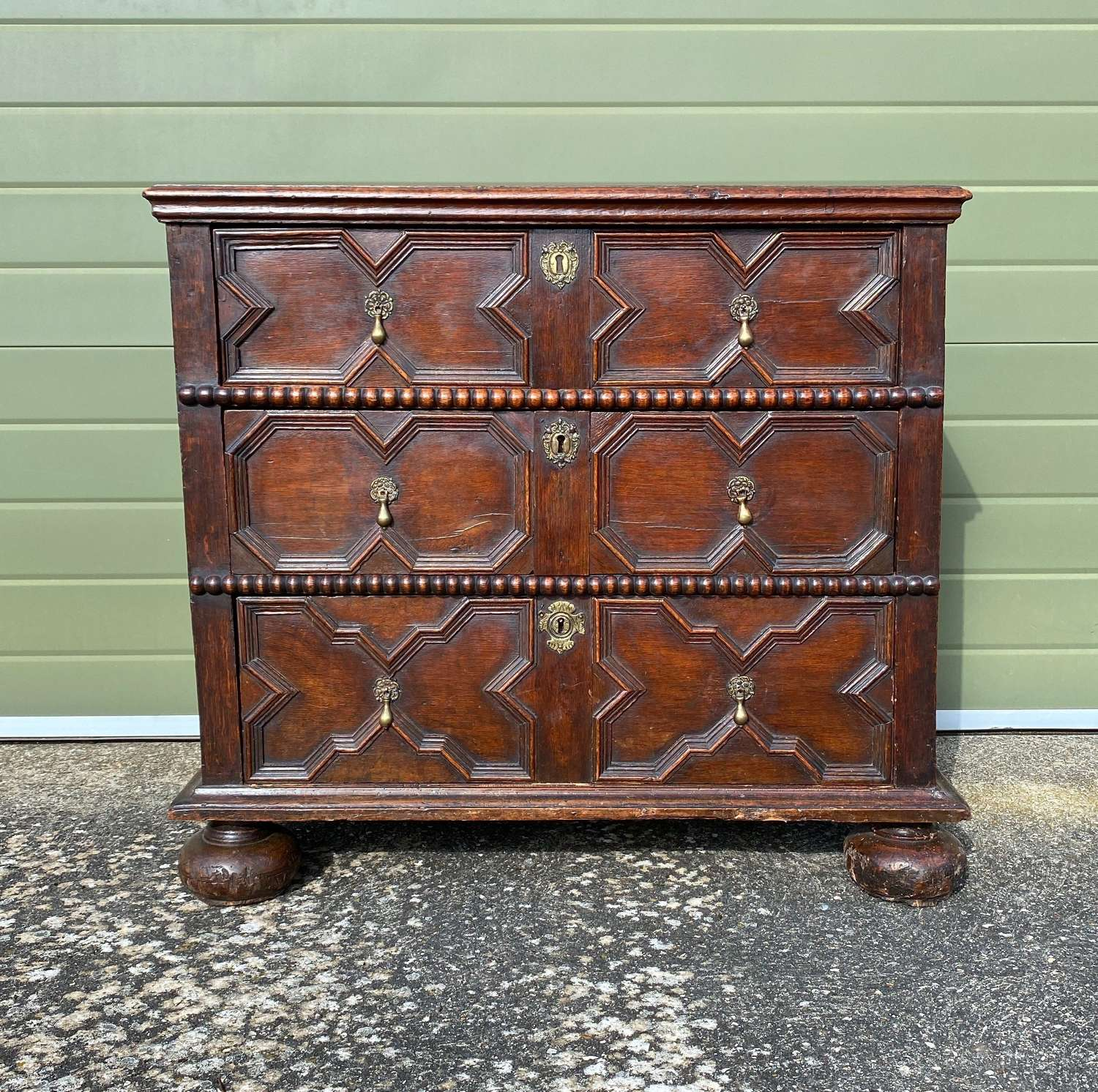 Early 18thC Oak Chest of Three Drawers with Geometric Moulded Fronts.